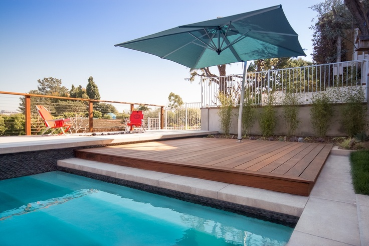 Raised ipe wood deck and umbrella shade by the pool for 9 fauna terrace coolum
