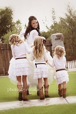 Outfits for family portraits- I usually love color, but these white dresses with cowboy boots are incredible! Id put the bright colors on mom and dad.