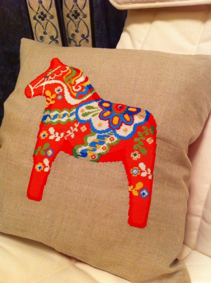 Dala Horse cross stitch cushion on evenweave. Made this myself from a pattern in Cross Stitcher mag. Am extraordinarily proud of myself, not least because it took over 70 hours to sew - not because it was difficult or anything!