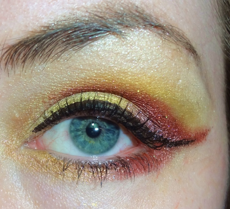 """(Since I didn't watermark this - this eye belongs to me, Brittani/vstorevigilante lol :p)  """"Girl on Fire"""" - my makeup I'm wearing tonight at work with my Hunger Games tshirt :)  Colors used: MOI - Maria; Antoinette's Revolution Cosmetics - Dauphin; MOI - Sinful; DarlingGirl Cosmetics - Sex Kitten, DarlingGirl Cosmetics - Lemon Meringue; Glamourdoll Eyes - Skin of a Killer. + liquid liner & lash styletto mascara :)"""