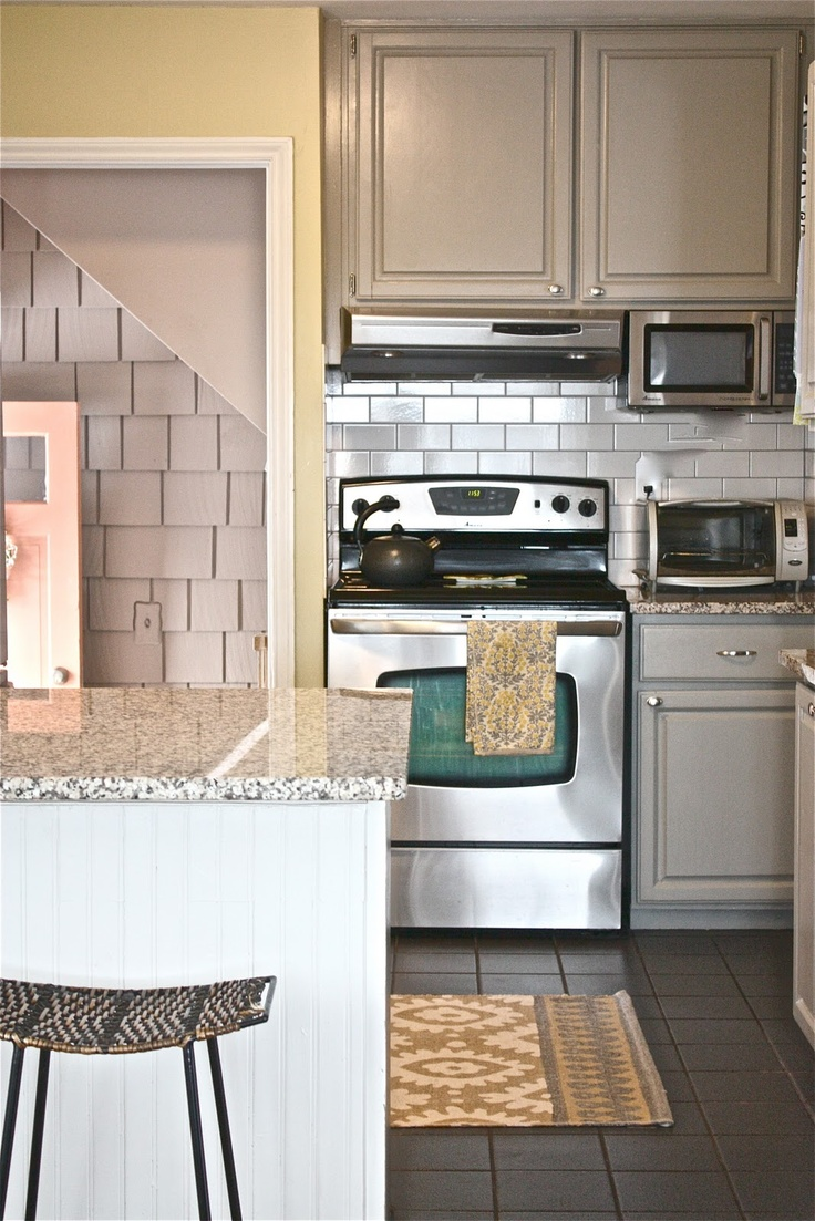 Gray cabinets greenish yellow walls white subway tile for Grey yellow kitchen ideas