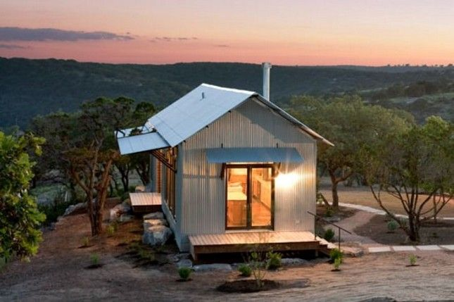 How cool is this prefab porch house?