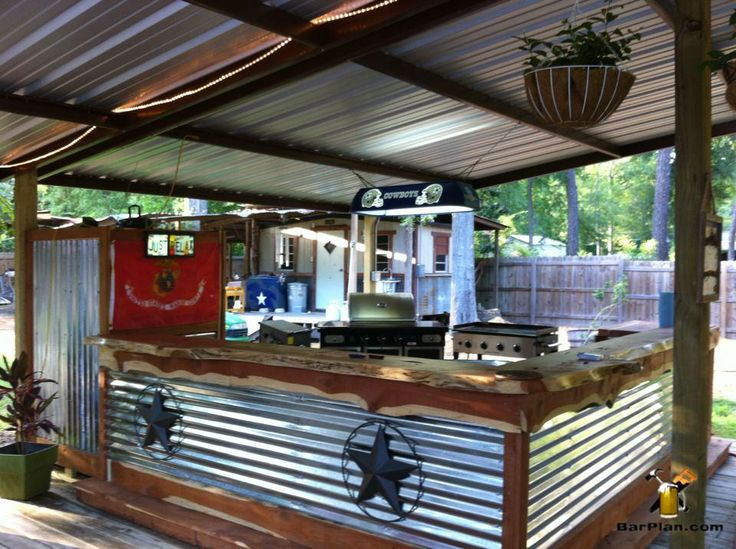 Awesome outdoor bar and grill area under protective shed ...