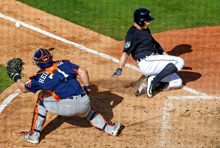 2017 spring training:     Slide in time:    The Tigers' Alex Presley slides safely into home as he beats the throw to Astros catcher Tyler Heineman on Feb. 25 at Joker Marchant  Stadium in Lakeland, Fla.