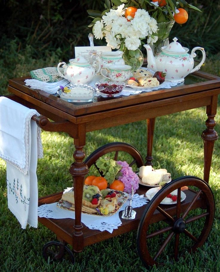 I need one of these lovely tea carts. Afternoon tea in the garden......looks very inviting