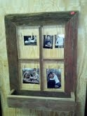This is a barnwood frame with planter box attached at the bottom.  Rusty wire is strung across with clothespins attached to display your snapshots.  Add garland, pipberries or twigs to the box for a great primitive look.