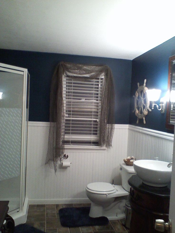 Nautical bathroom theme. Put fish net over dark ble curtains w a few white star fish and red rustic lures.