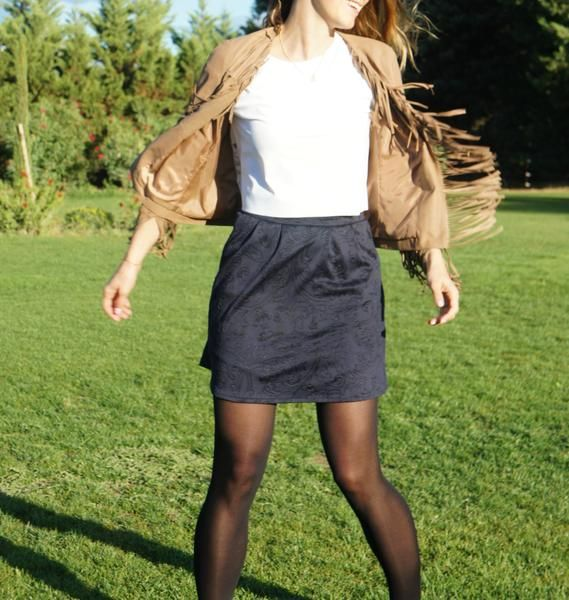 Navy fabric with black patterns for Powerful, a lovely mini skirt. 100% handmade in Great Britain like all the Beyond Your Clouds skirts! https://www.beyondyourclouds.com/products/powerful-skirt