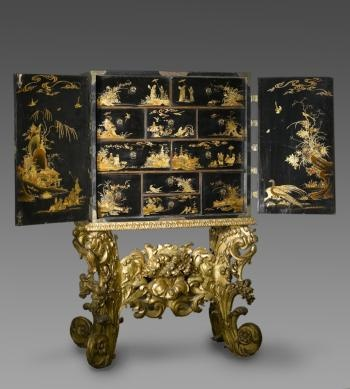 DescriptionCabinet with twin doors, of wood overlaid with black lacquer decorated with lacquer designs in gold in Chinese style, on a stand of wood covered with gesso and gilt with legs and stretcher carved with leafy scrolls and flowers: English, c. 1670 - 1675Production informationEngland, EuropeDatec. 1670 - 1675