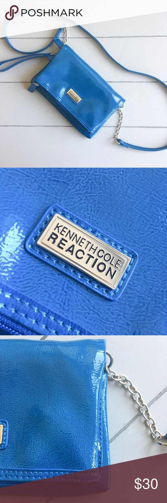 Kenneth Cole Reaction Blue small cross-body bag Royal blue glossy croc foldover bag with chain and leather strap that comes off so it can be used as a wristlet or clutch. Like new, with a tiny defect, the back of the bag has some very very slight discoloration, looks like water spots, but it won't come off, see pictures. Doesn't affect the look at all, just want to disclose everything. Other than that, this bag is in excellent like-new condition with no other signs of wear! All reasonable…