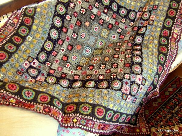 Such gorgeous colours and textures in the granny square rug. More lovely pictures on this link