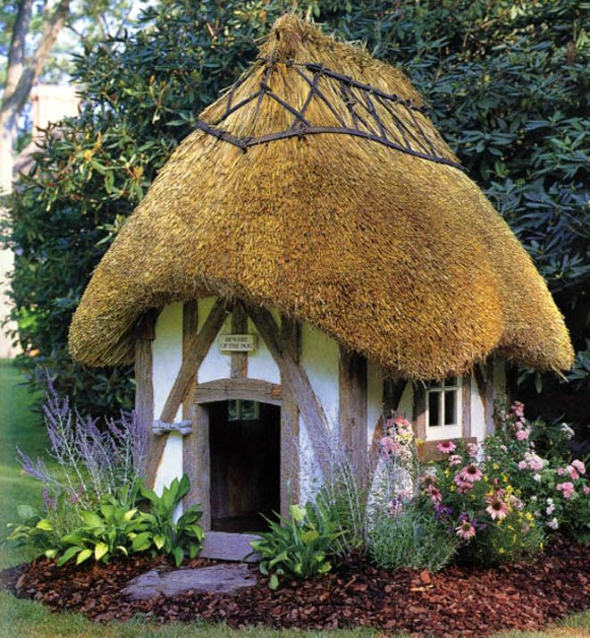 this dog house looks like it was stolen from right out of a fantasy novel - Beautiful Dog Houses