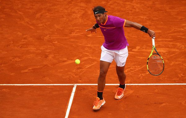 Rafael Nadal Photos Photos - Rafael Nadal of Spain plays a backhand against Albert Ramos-Vinolas of Spain in the final on day eight of the Monte Carlo Rolex Masters at Monte-Carlo Sporting Club on April 23, 2017 in Monte-Carlo, Monaco. - ATP Masters Series: Monte Carlo Rolex Masters - Day Eight