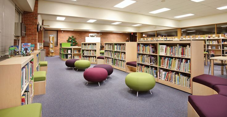 Washington Elementary School uses low shelving and curved benches to create a unique landscape in their new playful school library.