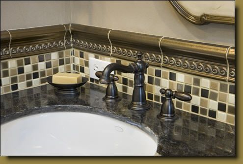 Love the idea of tiles around the sink!