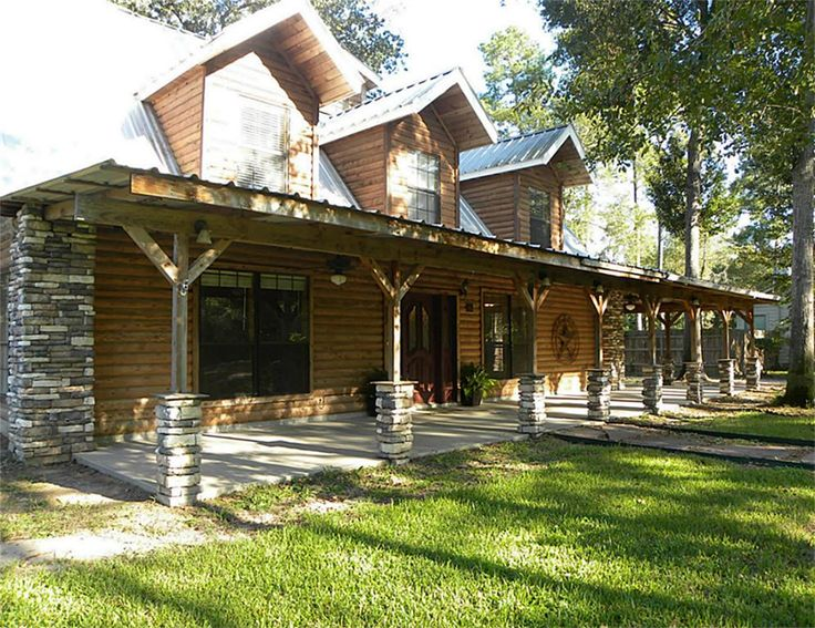 Wrap around porch cement slab no rails metal roof for Full wrap around porch log homes