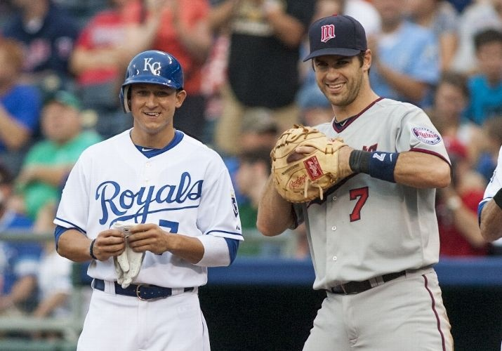 Right fielder David Lough #7 of the Kansas City Royals is congratulated by first baseman Joe Mauer #7 of the Minnesota Twins after getting his first major league hit during the second game of a doubleheader at Kauffman Stadium on September 1, 2012 in Kansas City, Missouri.