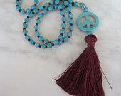 Peace Tassel Necklace, Turquoise and Burgundy Beads, burgundy/garnet silk tassel, Turquoise Peace Pendant, Boho Chic, Rustic Chic, Boho Glam