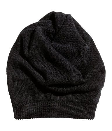Tube-shaped, fine-knit hat. Twisted, with an opening at top.
