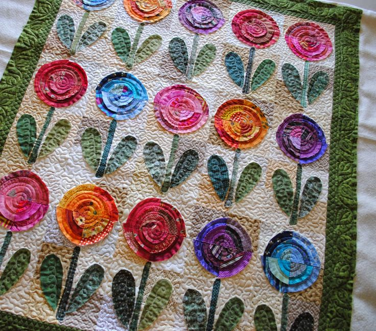 Love the bright colors and textures of this Bullseye flower quilt! Even though the quilting is super simple it really adds to the over all texture of the quilt.