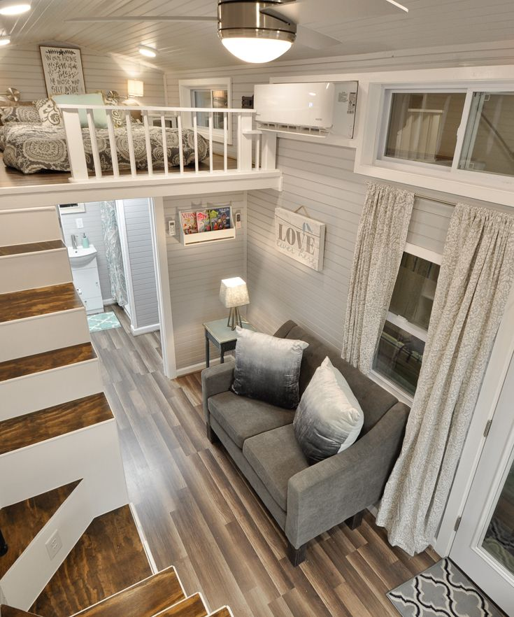 The 412-square-foot house includes two king size bedroom lofts with storage staircases to each loft.