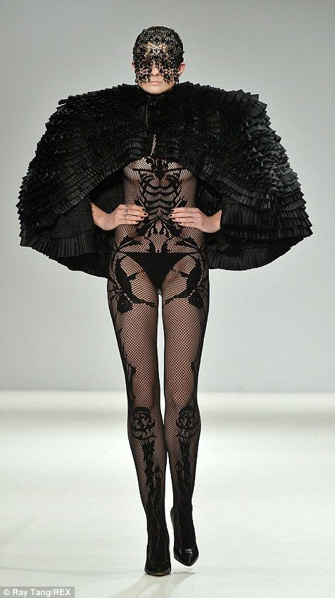 Dominatrix-esque models took to the runway at Marko Mitanovski wearing fishnets and exposi...