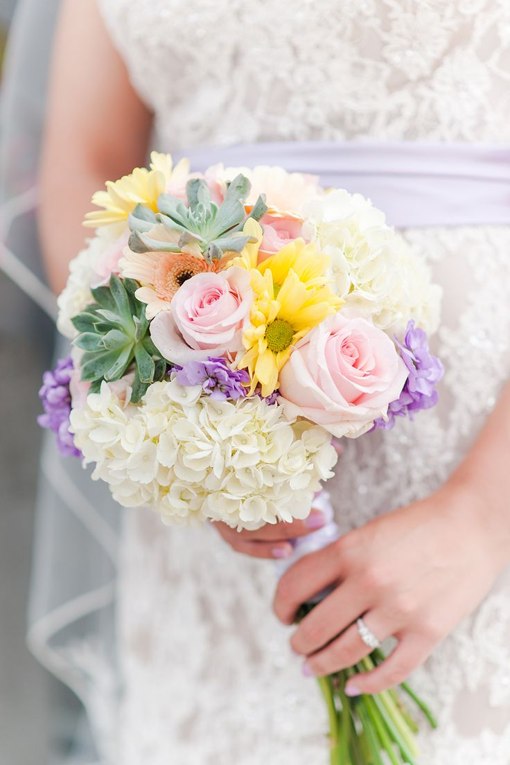 This pastel flower bouquet with pink roses, hydrangeas, and succulents is gorgeous! 3Eight Photography captures all the details you will like to relive over and over again. Click the image to learn more. Photo credit: 3Eight Photography