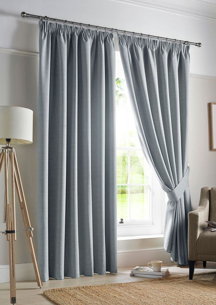 Darwin Blackout Sky Pencil Pleat - Blue curtains with a plain texture that evoke a  sense of calm.