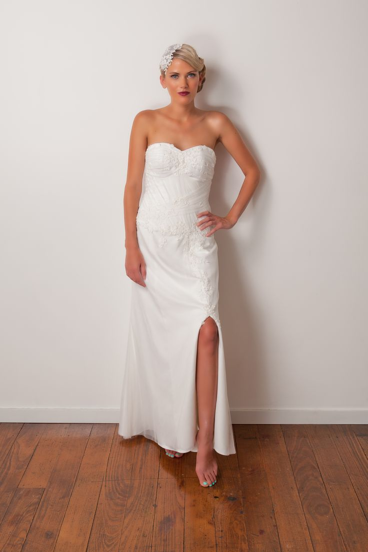 'Indianna' gown. Soft A-line gown with delicate embroidered flowers along the bodice. Sweet and minimal.