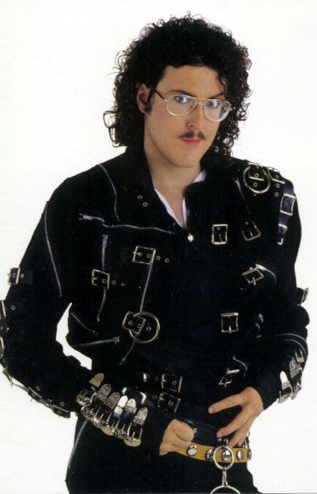 Weird Al Yankovic.  The Will Ferrell of music videos in the 80's.