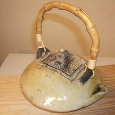 Poterie décorative création raku théière jaune , nitrate d'argent