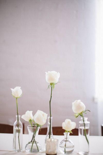 Simple white stems in simple bud vases