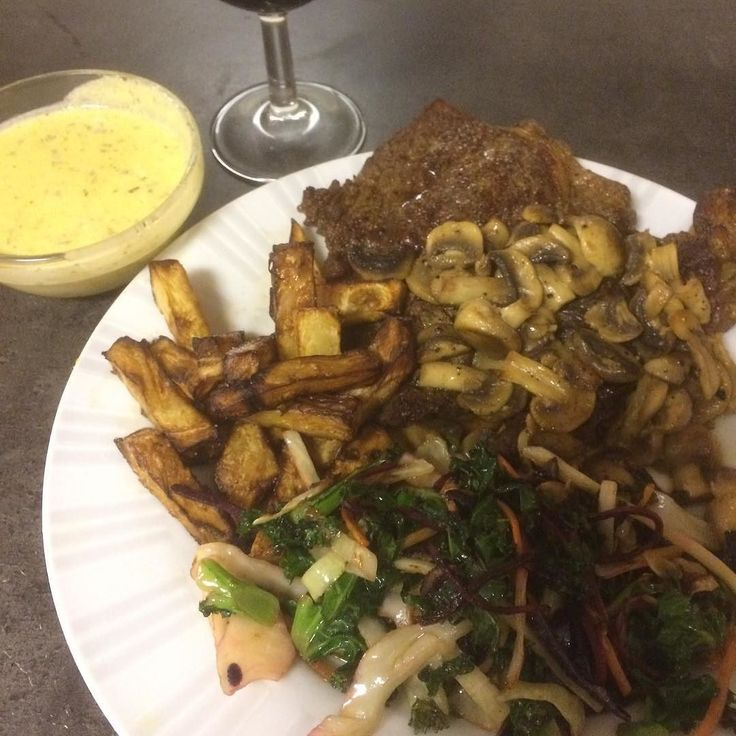Day 2 of back on low carb so far so good. I have a bit of cravings but nothing that sugarfree soda can't kill. Dinner was entrecôte steak celery root fries champignons and a warm salad of kale beet root and green and red cabbage. Sauce is a cheat bearnaise. And a glass of wine of course. #entrecote #steak #celeryrootfries #cheatbearnaise #lowcarb #dinner by inguzborgus