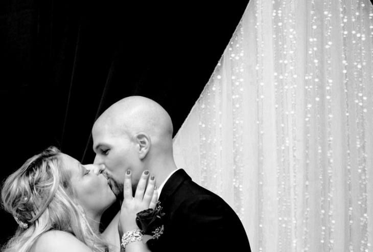 Black and white and sparkly wedding backdrop reflecting the wedding decor. soft and sweet kiss. from photo42.ca Brampton wedding photographer. Packages from $1000