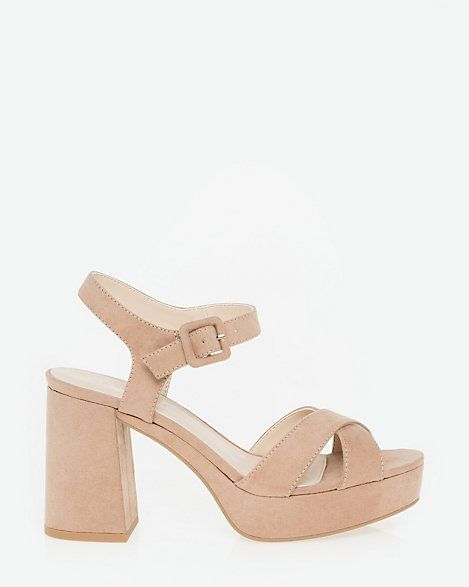 Suede-Like Criss-Cross Sandal - A flared block heel and bold criss-cross straps define the perfect going-out sandal.