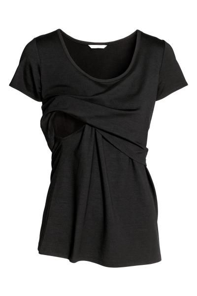 Flared top in soft viscose jersey with a unique nursing feature – double layer at top helps retain warmth while allowing easier nursing access. Short sleeve