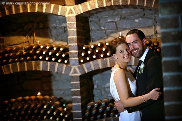 Kilronan Castle Ireland bride & groom portrait in a wine cellar