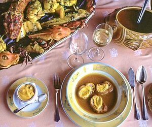 Image of traditionally-prepared bouillabaisse on a table in Marseille