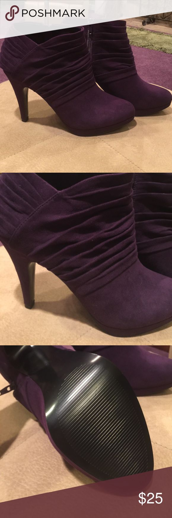 Size 8.5 purple ankle boots Size 8.5 purple ankle boots. New, never worn except to try them on sitting down, only to realize at home that my knee injury is NOT fond of heels this high! Sexy & drool-worthy.  Come & get 'em! Coach & Four Shoes Ankle Boots & Booties