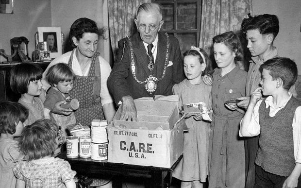 How Care packages sent by ordinary people helped save British lives after World War Two - Telegraph The Mayor of Hertford delivers a Care package to children of the town Photo: ©1947 CARE