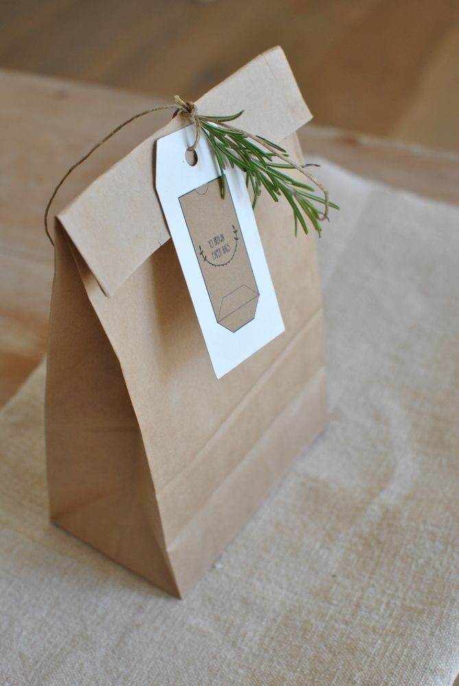 brown paper bag with twine tied rosemary sprig label ...