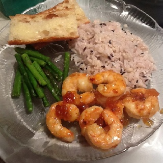 Pink peppercorn glazed shrimp, rice pilaf w/forbidden rice and sautéed asparagus. Chewy Italian bread and butter, YumMe!