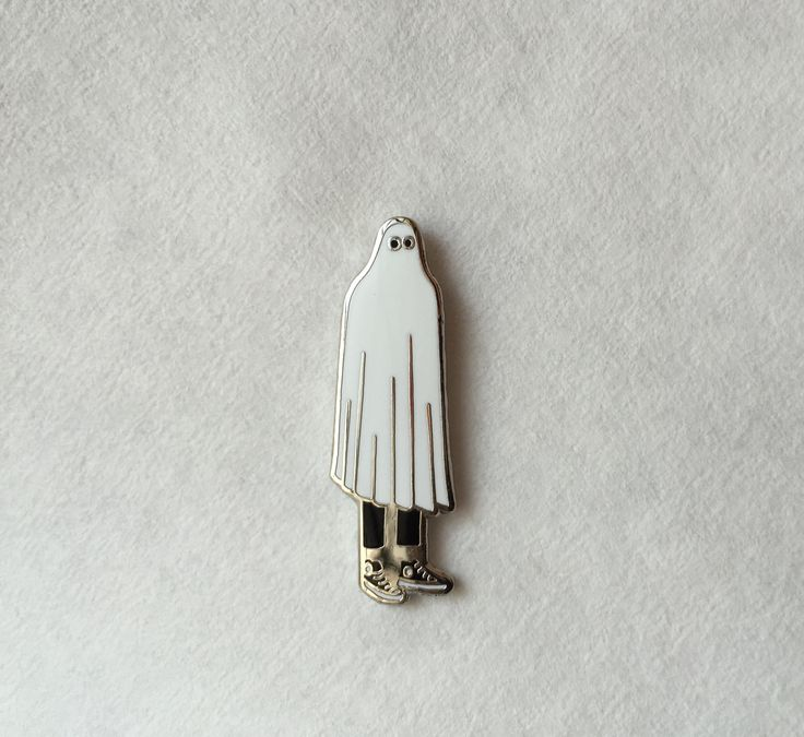 Forgetting to wear socks is a DEAD giveaway to your disguise, Mr. Ghost!-1.25 Inches-Hard Enamel-Shiny Nickel Metal Finish-Includes Rubber Clutch
