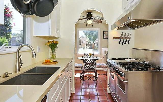 Galley Kitchen With Saltillo Tile Floors. Romantic 1930