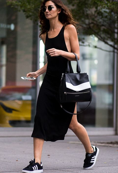 Lily Aldridge in adidas Gazelle trainers and black maxi dress