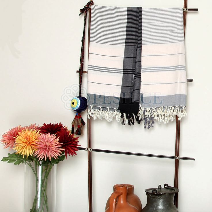Dilruba Peshtemal is 100% natural Turkish cotton. Fringed. Absorbs water and dries quickly. Light and space saving.Hand loomed in Turkey