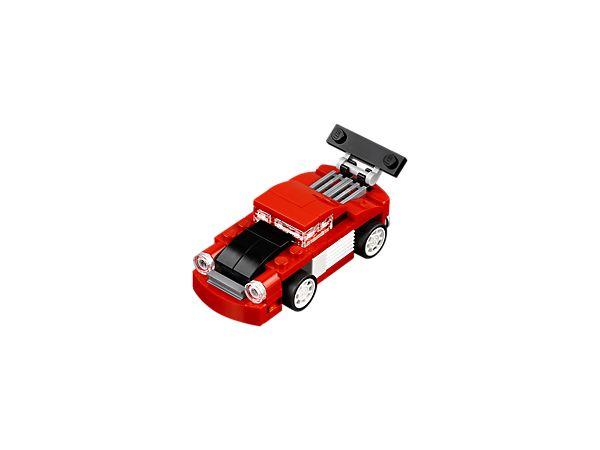 """Oto Czerwona wyścigówka z zestawu """"3 w 1""""! Ma regulowany spojler, silnik z tyłu i okrągłe reflektory, a pomalowana jest na czerwono, biało i czarno. </li><li> Model można przerobić na samochód pomocy drogowej lub samochód wyścigowy."""