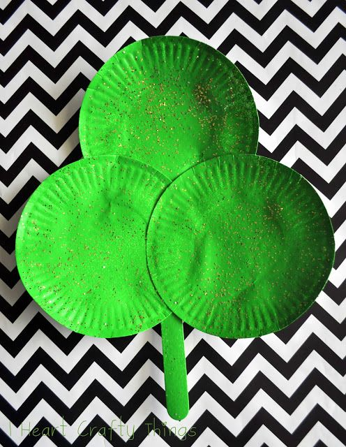 Paper Plate Shamrock, a holiday craft idea for kids. Paper plate, green paint, a popsicle stick and glitter. St. Patrick's Day.