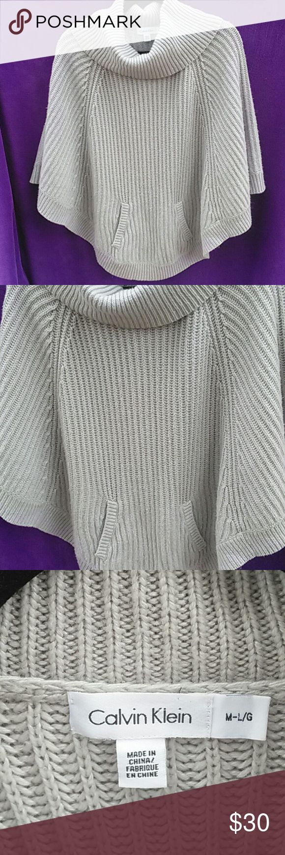 Calvin Klein poncho with closure buttons Calvin Klein poncho with closure buttons on lower left and right for closure as desired. Pre-owned and inspected for sign of wear. Now $21 down from $27!!!!! Calvin Klein Sweaters Shrugs & Ponchos
