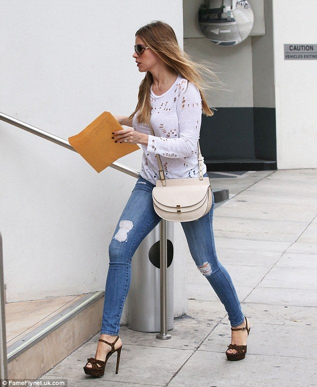 Bling: The 43-year-old actress wore her shiny rock, via Joe Manganiello, with sky high heels to run errands
